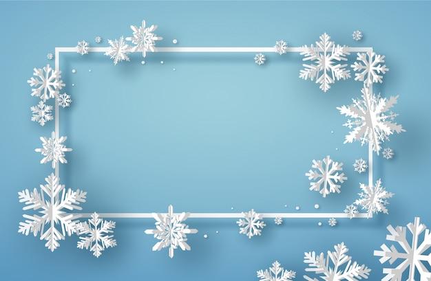 Vrolijke kerstkaart met vierkant kader en wit origamisneeuwvlok of ijskristal op blauwe achtergrond Premium Vector