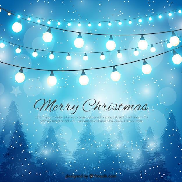 Vrolijke kerstmis en lichtenachtergrond Gratis Vector
