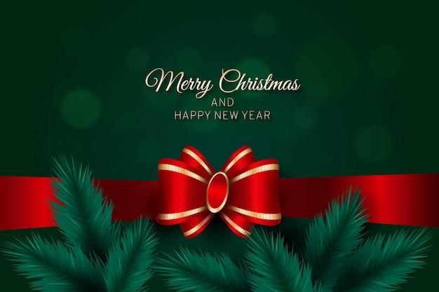 Vrolijke kerstmis met lint en pijnboombladeren Gratis Vector