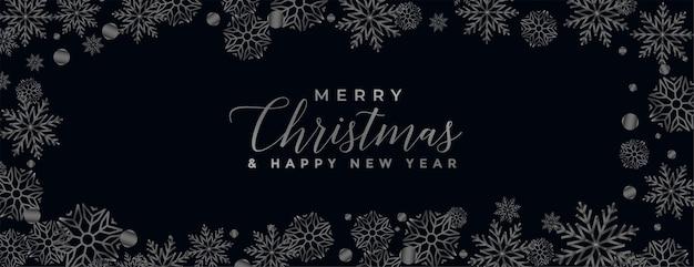 Vrolijke kerstmis zwarte achtergrond met sneeuwvlokkengrens Gratis Vector