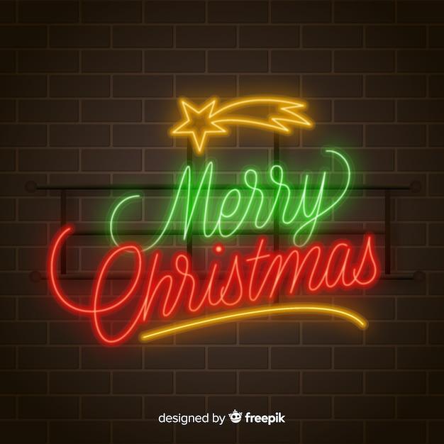 Vrolijke kerstmisachtergrond van het neon Gratis Vector