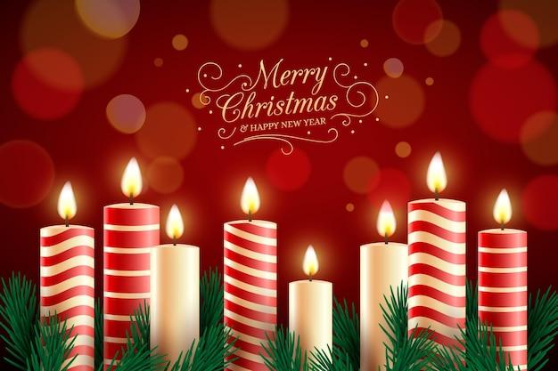 Vrolijke kerstmistekst met kaarsenachtergrond Premium Vector