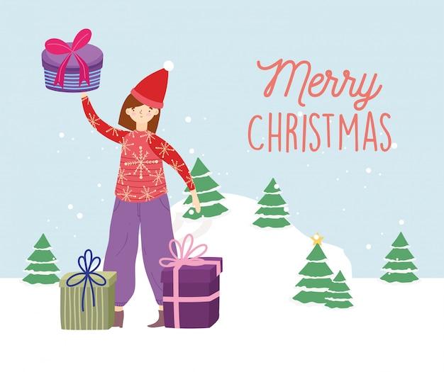 Vrolijke kerstmisvrouw met de lelijke viering van de de bomensneeuw van sweatergiften Premium Vector