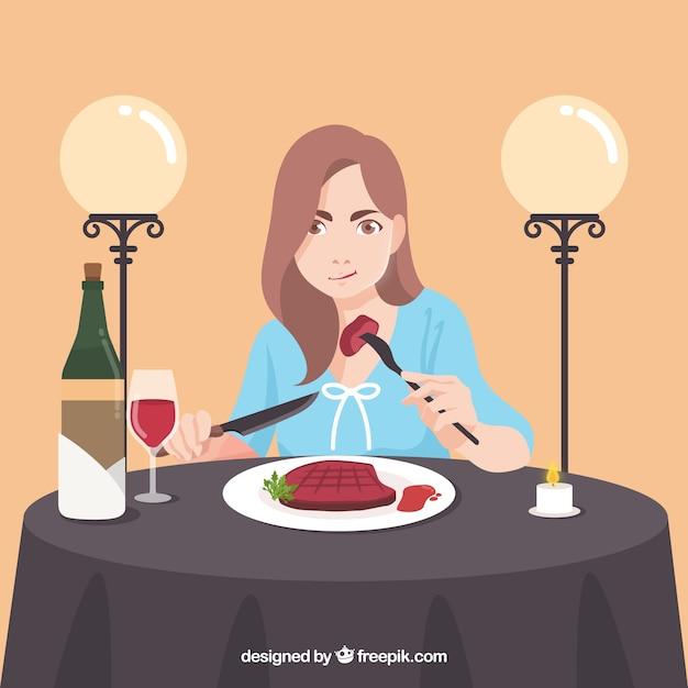 Vrouw die een biefstuk in een elegant restaurant eet Gratis Vector