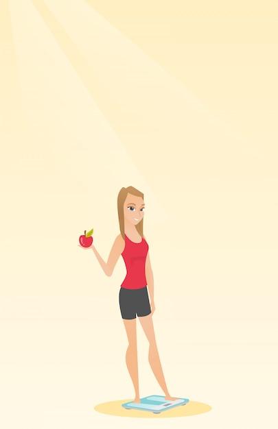 Vrouw die zich op schaal bevindt en appel in hand houdt. Premium Vector