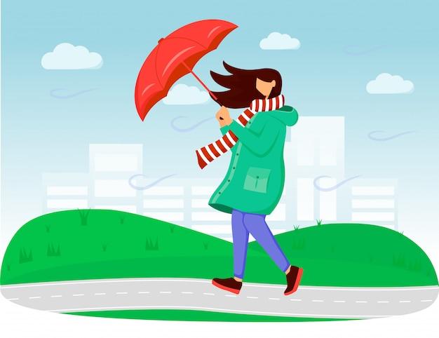 Vrouw in illustratie van de regenjas de vlakke kleur. winderig weer. regenachtige dag. vrouw met paraplu. wandelen kaukasische dame in sjaal gezichtsloze stripfiguren met gras en lucht op de achtergrond Premium Vector