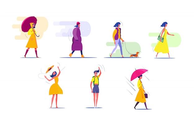 Vrouw in verschillende seizoenen ingesteld Gratis Vector