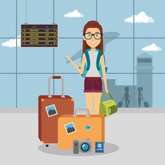 Vrouw reiziger op de luchthaven Gratis Vector
