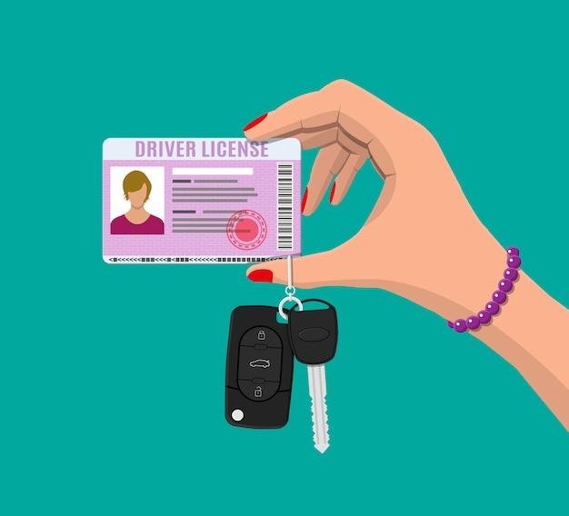 Vrouw rijbewijs auto, autosleutels in de hand Premium Vector