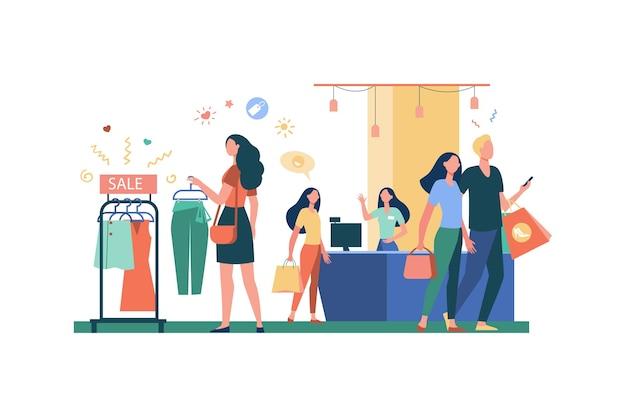 Vrouwen die kleren in kledingwinkel kopen geïsoleerde vlakke vectorillustratie. cartoonmeisjes en consumenten die moderne kleding, kledingstuk of jurk kiezen. modewinkel en stijl Gratis Vector