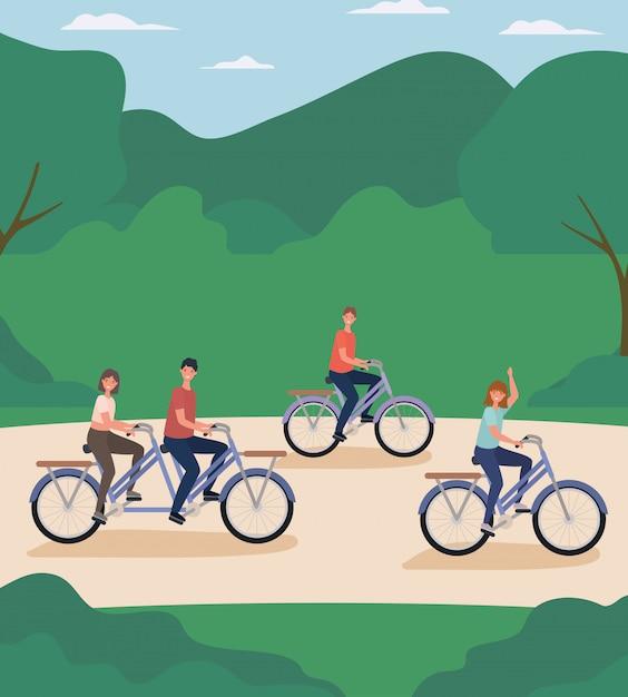 Vrouwen en mannen cartoons fietsen in het park Premium Vector
