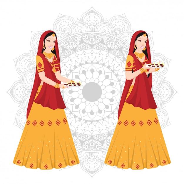 Vrouwen in indiase traditionele kleding op mandala. Premium Vector