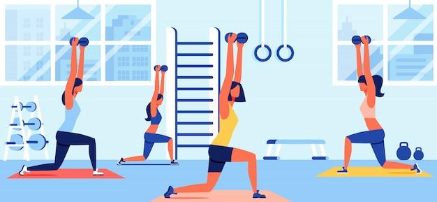 Vrouwen in sportkleding training met halters in gym Premium Vector