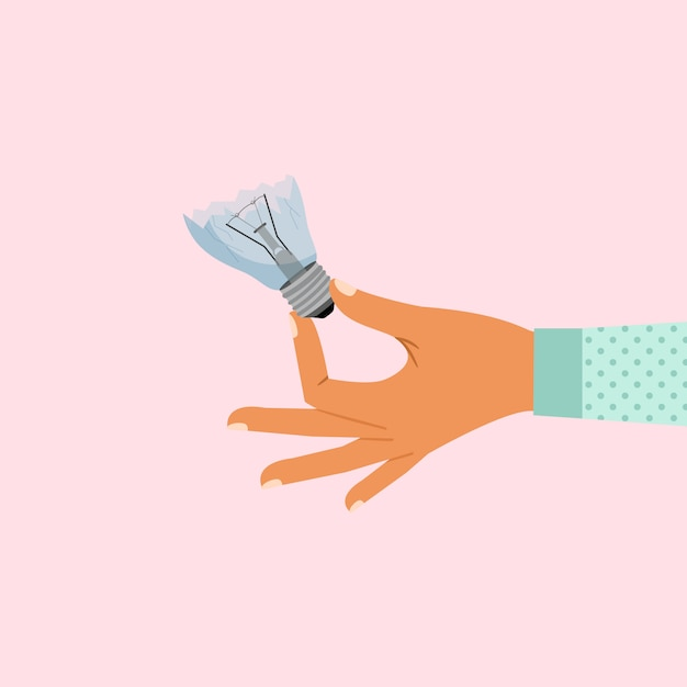 Vrouwenhand die gebroken lightbulb houden Premium Vector