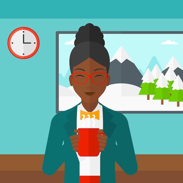Vrouwenzitting met kop van koffie Premium Vector