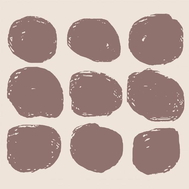 Vuile cirkelvormige grunge vlek set van negen Gratis Vector