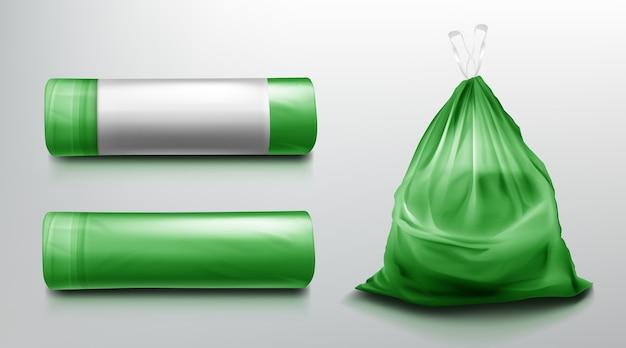 Vuilniszaksjabloon, plastic rol en zak vol vuilnis. groen wegwerpverpakking voor afvalmodel. huishoudelijke benodigdheden voor afvalworp geïsoleerd op een grijze achtergrond. realistische 3d-afbeelding Gratis Vector