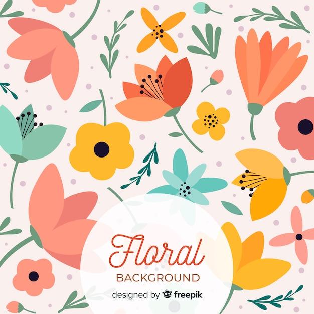 Warm gekleurde bloemen platte achtergrond Gratis Vector