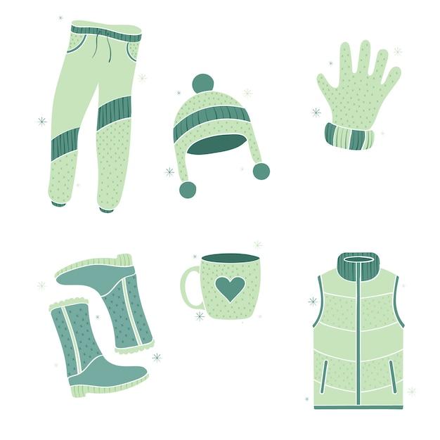 Warme kleding voor een koude winter getrokken hand Gratis Vector
