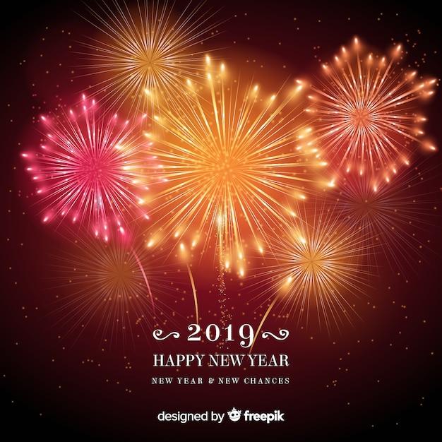 Warme tonen vuurwerk nieuwe jaar achtergrond Gratis Vector