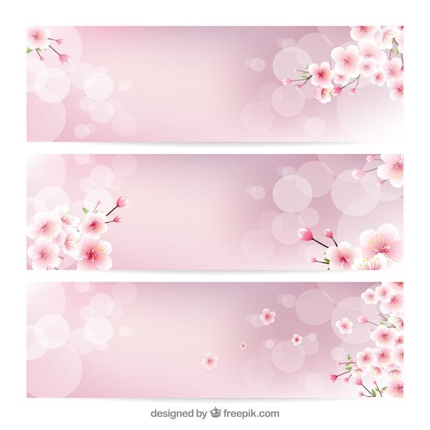 Wazig banners met decoratieve kersenbloesems Gratis Vector