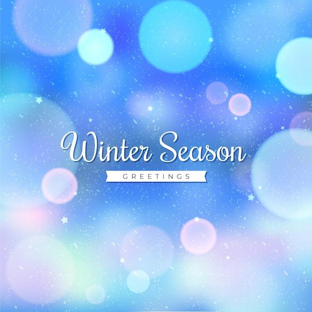 Wazig licht met wintertekst Premium Vector