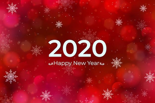 Wazig nieuwe jaar 2020 achtergrond Gratis Vector