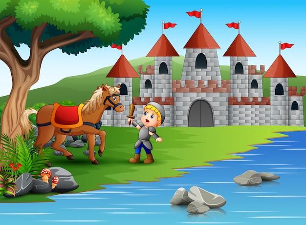 Weinig ridder vecht tegen een paard in een kasteellandschap Premium Vector