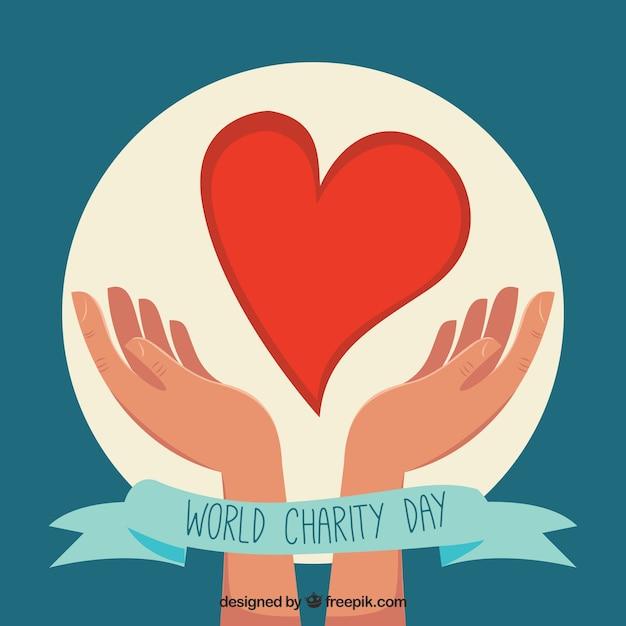 Wereld liefdadigheidsdag achtergrond van handen met een hart Gratis Vector