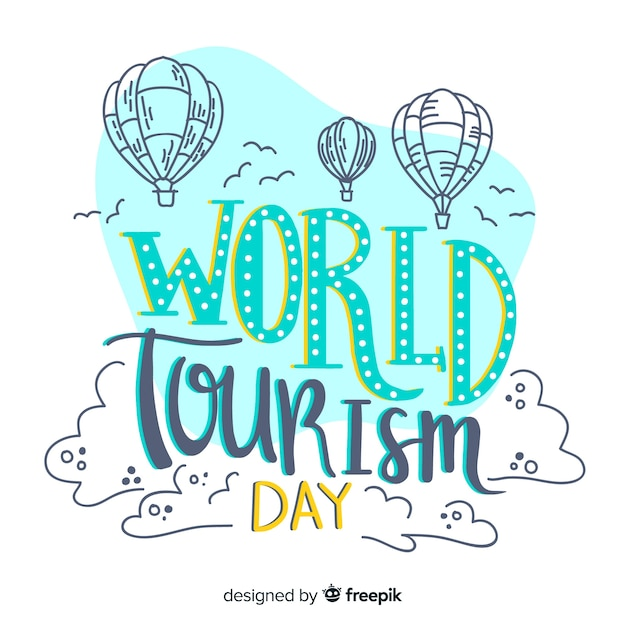 Wereldtoerisme dag belettering met lucht ballonnen Gratis Vector