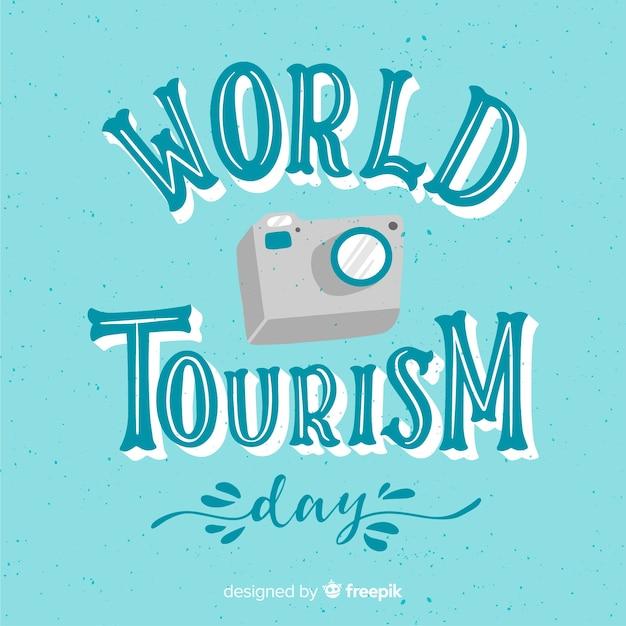 Wereldtoerismedag met camera Gratis Vector