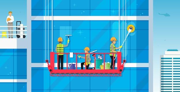 Werknemers reinigen het glazen gebouw met een veilige kraan Premium Vector
