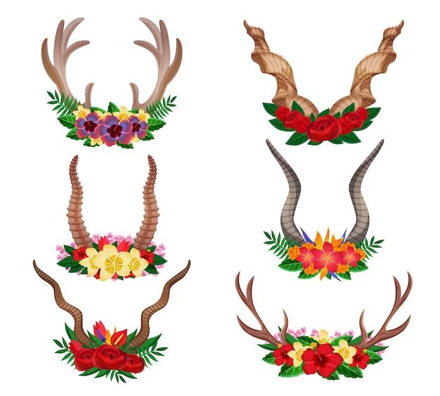 Wilde dieren beste berggeit eland sier bloemenhoorns geplaatst versierd met bloemstukken geïsoleerd Gratis Vector