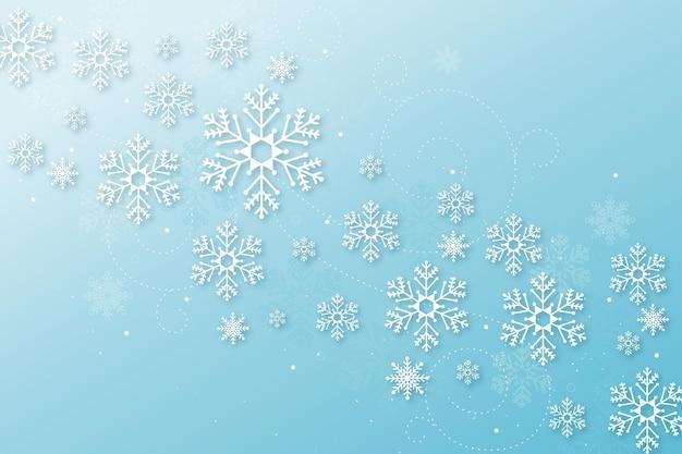 Winter achtergrond in papieren stijl Gratis Vector