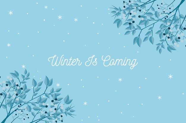Winter komt tekst op blauwe achtergrond Gratis Vector
