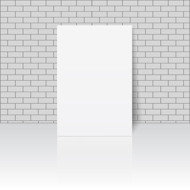 Witte blanco vel papier of fotolijst op metselwerkmuur Premium Vector