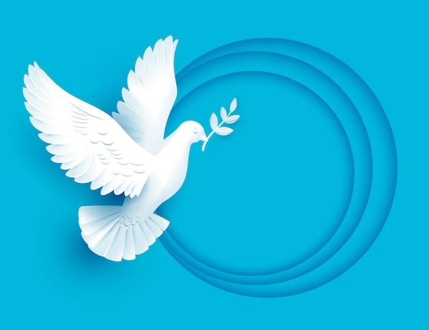 Witte duif houdt takjesymbool van vrede Premium Vector