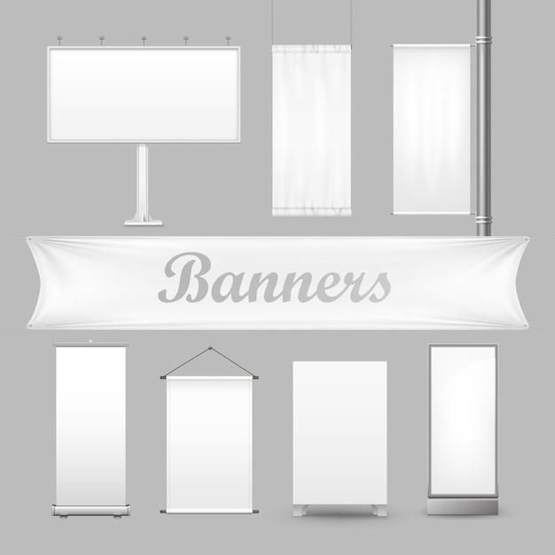 Witte lege textiel reclamebanners met plooien. de showcabine met lege poster of aanplakbiljet ingesteld voor reclame geïsoleerd op een grijze achtergrond Premium Vector