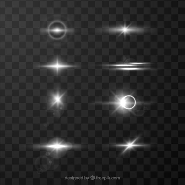 Witte lens flare-verzameling Gratis Vector