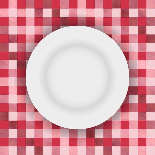 Witte plaat op een picknick tafelkleed Gratis Vector