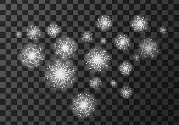Witte sneeuwvlokken op transparant Gratis Vector