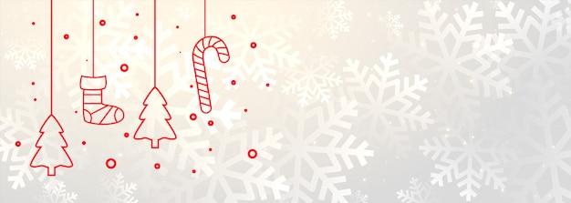 Witte vrolijke kerstmisbanner met kerstmisdecoratie Gratis Vector
