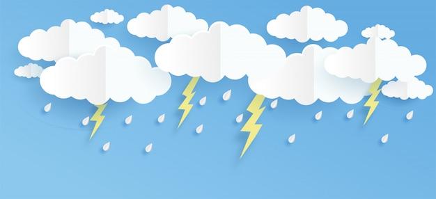 Wolk en regen op blauwe achtergrond in papier knippen en ambachtelijke stijl. Premium Vector