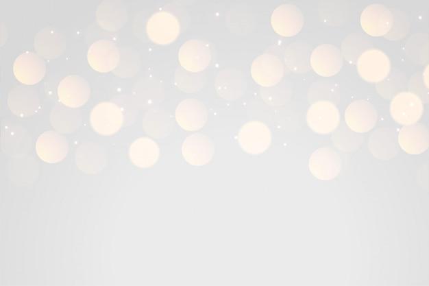 Zachte grijze bokeh lichteffectachtergrond Gratis Vector