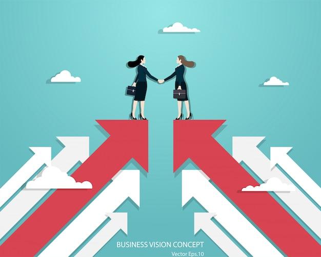 Zakelijke vrouwen partners handshaking over business Premium Vector