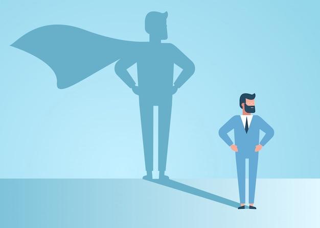Zakenman droomt ervan een superheld te worden. de zekere knappe jonge illustratie van het de schaduwconcept van zakenman status superhero Premium Vector