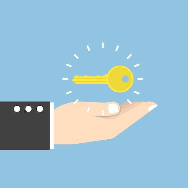 Zakenman met gouden sleutel over zijn hand Premium Vector