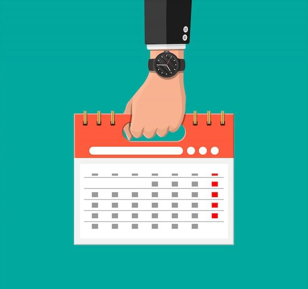 Zakenman met horloge en spiraalvormige in hand kalender Premium Vector