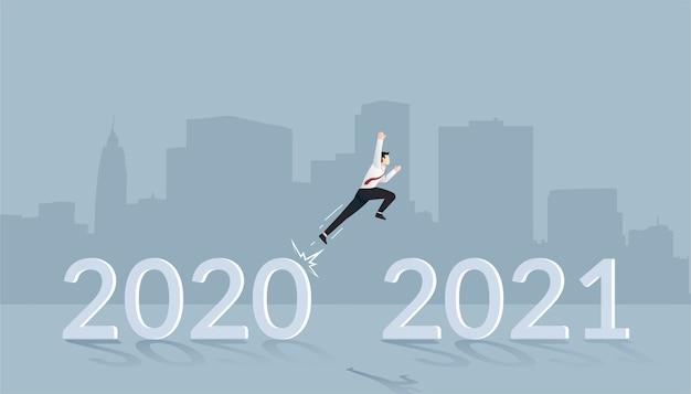 Zakenman springen op nieuwjaar concept voor nieuwe visie en planning Premium Vector