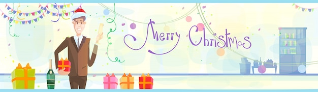 Zakenman vieren merry christmas Premium Vector